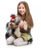 Little girl is with her dog Yorkshire Terrier Royalty Free Stock Image