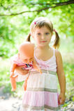Little girl with her doll Stock Photos
