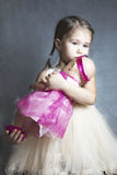 Little girl with her doll Royalty Free Stock Photos