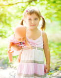 Little girl with her doll Royalty Free Stock Image