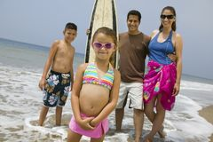 Little Girl with Her Family on Beach Royalty Free Stock Images