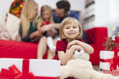 Little girl with her family in Chrismtas time Royalty Free Stock Photos