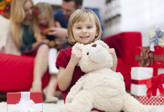 Little girl with her family in Chrismtas time. Look! It's my christmas gift from Santa Claus Stock Images