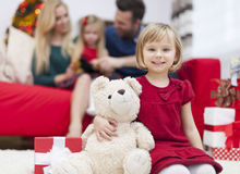 Little girl with her family in Chrismtas time Royalty Free Stock Images