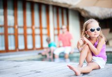 Little girl and her family on vacation Royalty Free Stock Photo