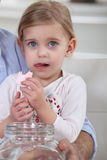 A little girl eating marshmallow. Royalty Free Stock Photos