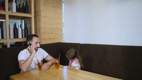 Little girl and her father dining at cafe.  stock footage