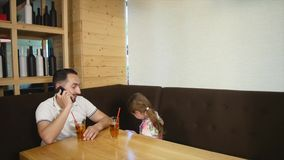 Little girl and her father dining at cafe.  stock video