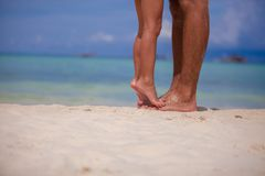 Little girl and her father feet at white sandy Royalty Free Stock Photo