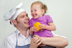 Little girl and her father having fun Stock Photo