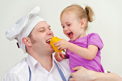 Little girl and her father having fun Royalty Free Stock Photo