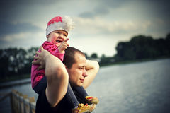Little girl with her father Royalty Free Stock Photos