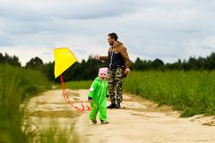 Young family with a child walking in the field royalty free stock photography