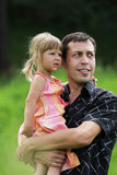 Little girl with her father on the natur Stock Image