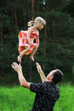 Little girl with her father on the natur Royalty Free Stock Photography