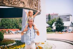 Little girl and her father on the outdoors. Stock Photo