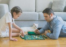 Family playing scrabble board game. Royalty Free Stock Image