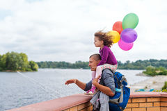 Little girl with her father at the river. Father Royalty Free Stock Photography