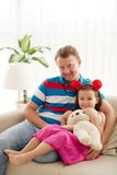 Little girl and her father Royalty Free Stock Photos