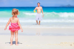 Little girl and her father on tropical beach Stock Image