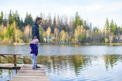 Little girl and her father walking near the lake Royalty Free Stock Image