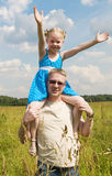 Little girl on her fathers shoulders Royalty Free Stock Image
