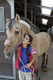 Little girl with her favorite horse Royalty Free Stock Image