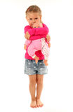 Little girl with her favourite doll. Isolated over white background Royalty Free Stock Images
