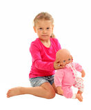 Little girl with her favourite doll. Isolated over white background Stock Images