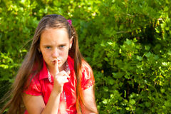 Little girl with her finger over her mouth Royalty Free Stock Photography