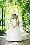 Little Girl with her First Communion Dress Stock Photography