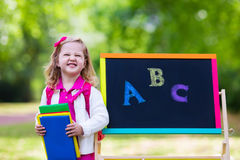 Little girl on her first school day Stock Photography
