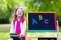 Little girl on her first school day Stock Photos