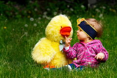 A little girl. With her friend on the grass Stock Images