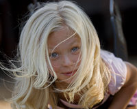 Little girl in her glory. Blonde girl on swing in park Stock Images