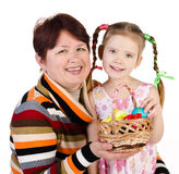 Little girl and her grandmother with basket full of easter eggs Stock Photography