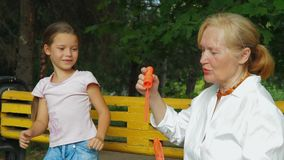 Little Girl And Her Grandmother stock footage