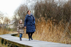 Little girl and her grandmother taking a walk Royalty Free Stock Image