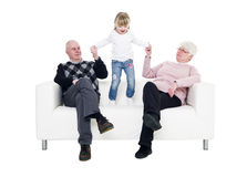 Little Girl with her grandparents Stock Image