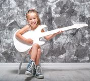 Little girl with her guitar Stock Photography