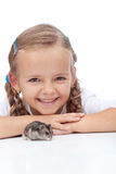 Little girl and her hamster Stock Photography
