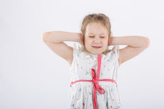 Little girl with her hands closed with her ears Royalty Free Stock Images