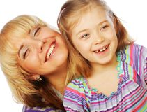Little girl with her happy mom isolated on white Stock Photography