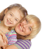 Little girl with her happy mom isolated on white Stock Photos