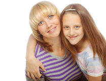 Little girl with her happy mom isolated on white Royalty Free Stock Images