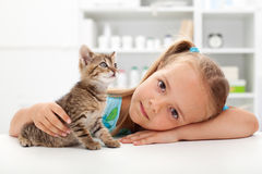 Little girl with her kitten Stock Photo