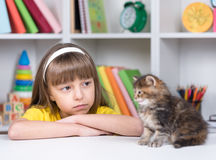 Little girl with her kitten Stock Photography
