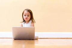 Little girl with her laptop computer Royalty Free Stock Photo