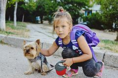 Little girl with her little friend on the walk Royalty Free Stock Photos