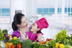Little girl with her mom cooking together Royalty Free Stock Photography